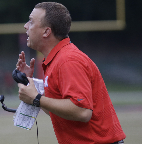 Newport head coach Matthew Schmitz gives instuctions  during their football game, Friday, Aug. 30,2014.