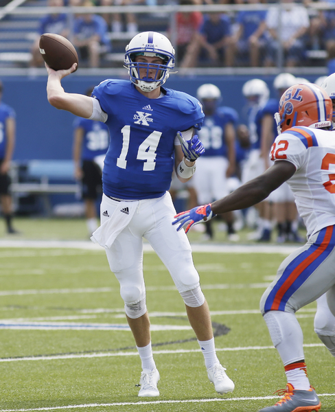St. Xavier's Sean Clifford throws the ball during the Bombers football game against East St. Loui