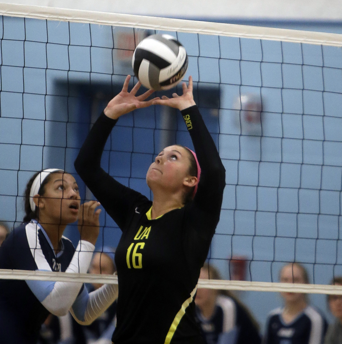 Ursuline's  Anne Debbane sets up a teamate  during the the Lions volleyball game against Mount Notre Dame,