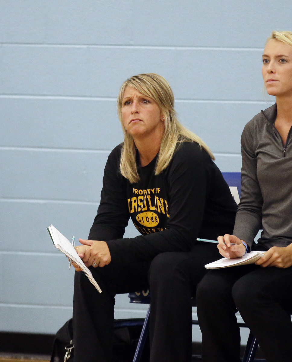 Ursuline coach Jeni Case on the bench during the Lions Volleyball game against Mount Notre Dame,