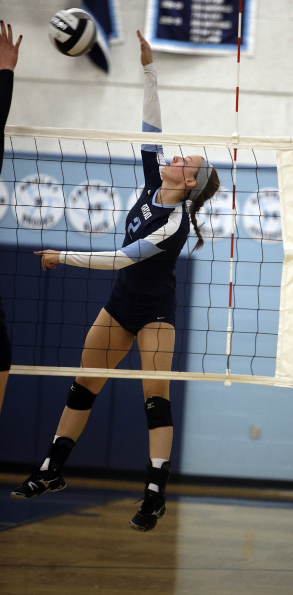 Mount Notre Dame's Maria Lingardo attempts a kill  during the the Cougars volleyball game against Ursuline