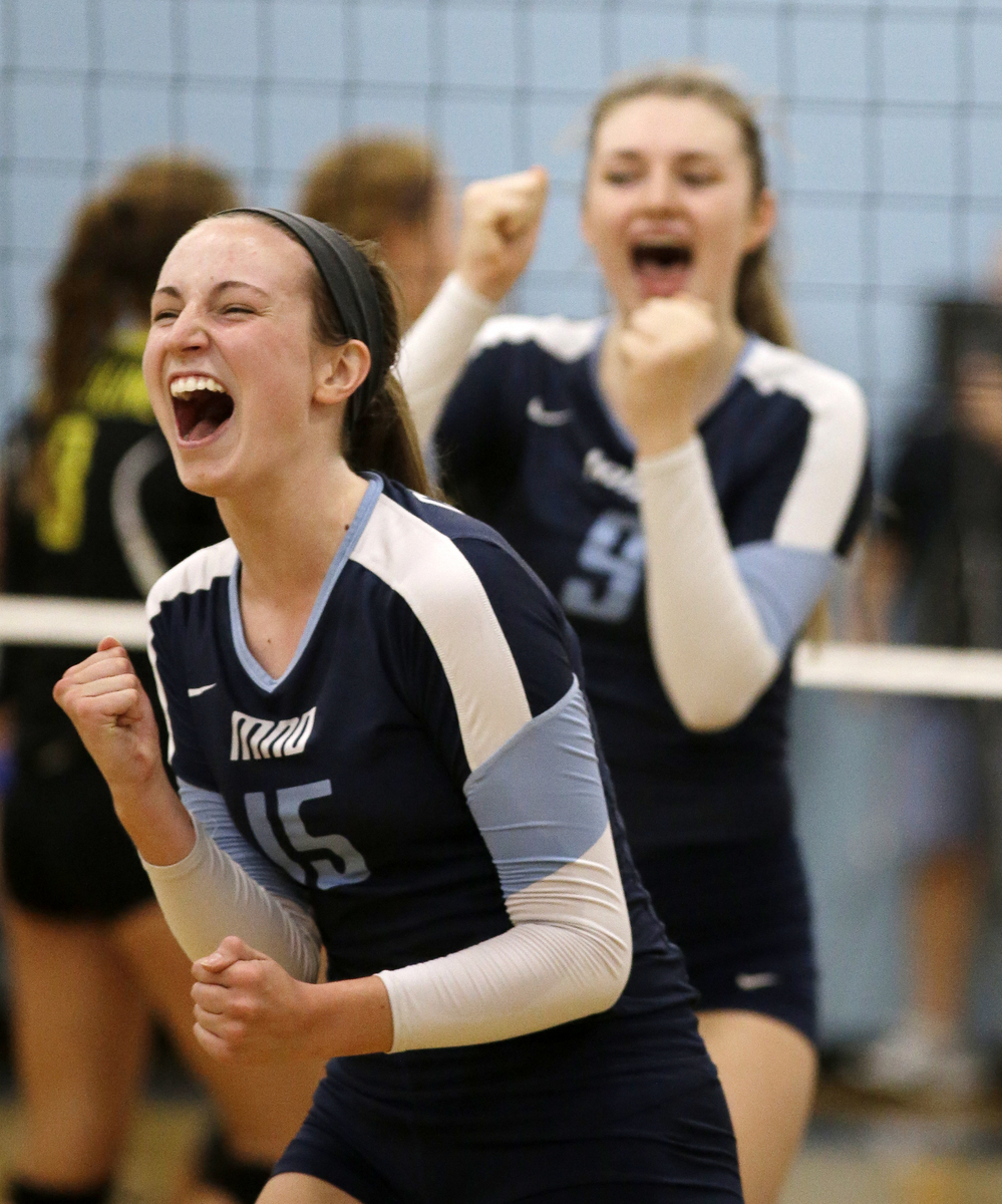 Mount Notre Dame's Jessica Towle(15)and Christine Carroll celebrate during the Cougars volleyball game against Ursuline