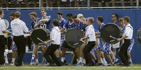 St. Xavier band performs at halftime of the Bomber's football game against East St. Louis.