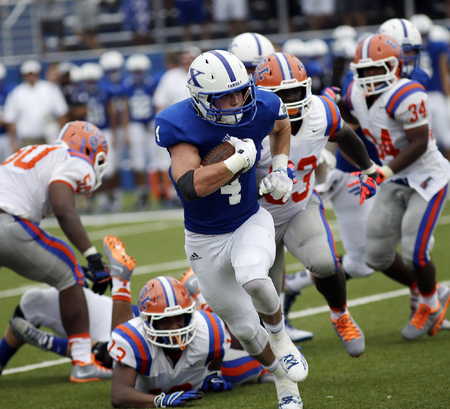 St. Xavier running back Ben Glines runs the ball for the Bombers during their football game against East  St. Louis