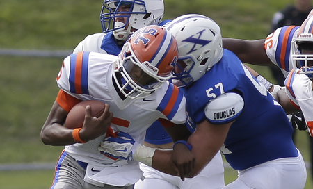 St. Xavier's Billy McConnell (57) tackles East St. Louis qb  Estes  Reyondous