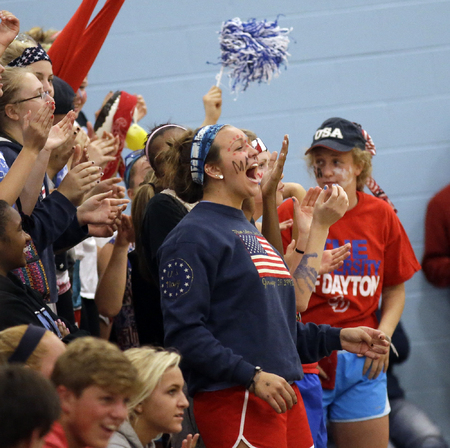 Mount Notre Dame fans celebrate during the Cougars Volleyball game against Ursuline. (