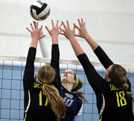 Mount Notre Dame's Dani  Szczepanski (10)  tries to get the ball past Ursuline's  Malllory Bechtold and Maggie Shannon during the their volleyball game