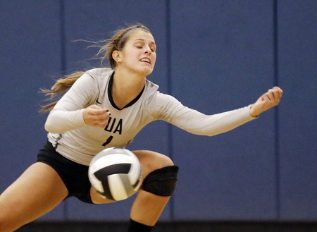 Ursuline's Avery Naylor  attempts to  save the ball during the Lions volleyball game against Mount Notre Dame,